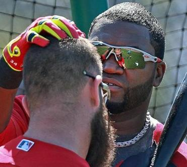Back in camp, David Ortiz greeted teammate Mike Napoli with a pat on the head and later gave his opinion on the media reaction to his contract request.